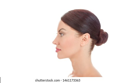 Beauty girl posing in side profile. Close up portrait serious beautiful woman looking to side in profile view showing clean skin fresh face, body isolated on white background with copy space.