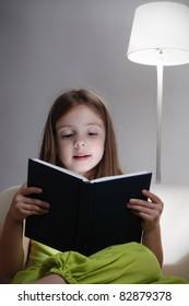 beauty girl read book on sofa