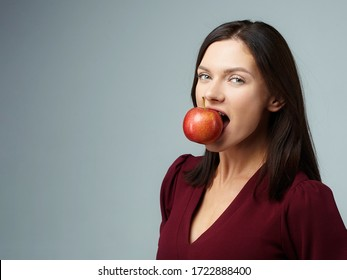 Beauty girl with red apple on white background