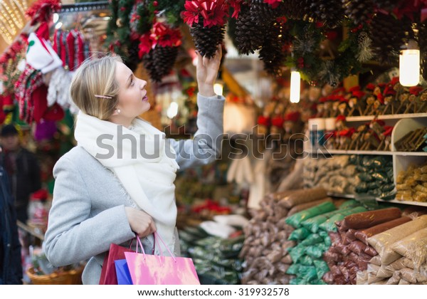 Beauty girl shopping at festive fair before Xmas