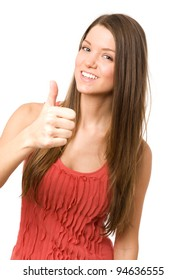Beauty girl showing thumbs up and smiling at camera