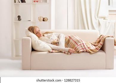 beauty girl sleeping on the sofa