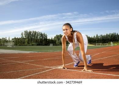 beauty girl start run on stadium