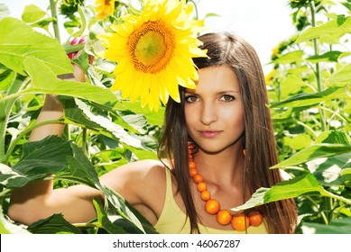 Beauty girl in a sunflower field