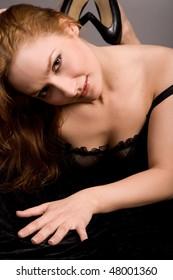 beauty girl in underwear on grey background