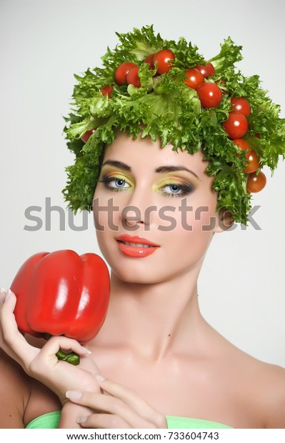 Beauty girl with Vegetables hair style. Beautiful happy young woman with vegetables on her head. Healthy food concept, diet, vegetarian food. Dieting concept.