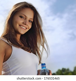 beauty girl with water bottle