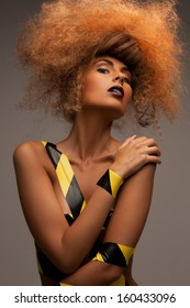 beauty and glamour concept - woman with long curly hair