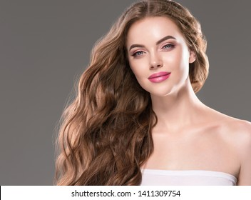 Beauty hair and skin woman natural makeup cosmetic concept beautiful young model