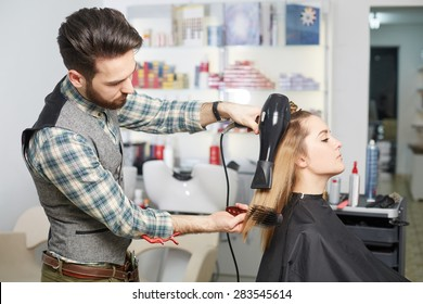 beauty, hairstyle and people concept. Happy young woman and hairdresser