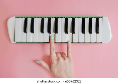 Beauty hand finger love sign playing on piano ,love music concept