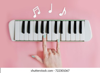 Beauty hand finger love sign playing on piano ,love music notes concept