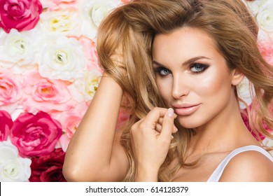 Beauty happy model girl with flowers