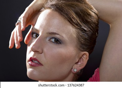 Beauty head shots. close up of female with exaggerated poses and jewelry.