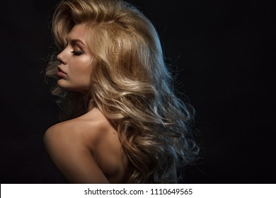 Beauty headshot of blonde model closeup portrait with classical hairstyle