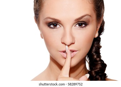 """Beauty head-shot of a young woman showing gesture """"keep silence"""""""