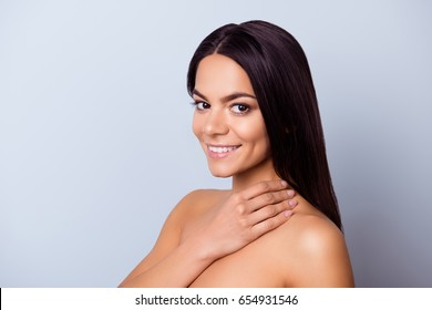 Beauty and health concept. Cose up cropped photo of pretty young latin american woman touching her skin and look so fresh, healthy and attractive