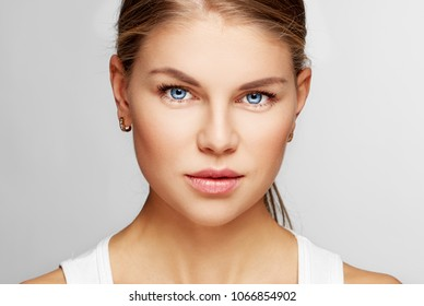Beauty and health. Studio portrait of pretty female with clean smooth skin.