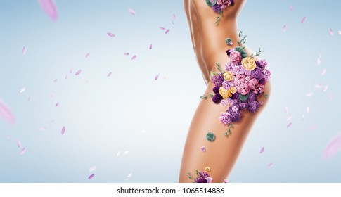 Beauty, healthcare. Beautiful woman with violet and yellow flowers on body