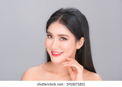 Beauty and healthcare. Portrait of young and beautiful asian woman on gray background