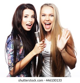 beauty hipster girls with a microphone singing