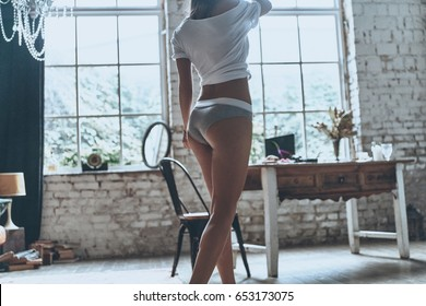 Beauty at home.  Close up rear view of young woman in underwear spending time at home