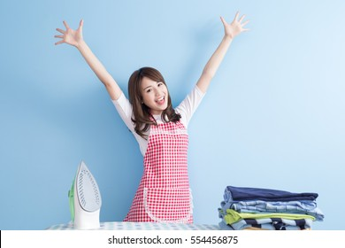 beauty  housewife with ironing and shirt isolated on blue background