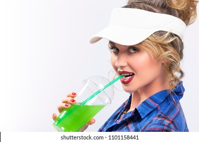 Beauty Ideas and Concepts. Sexy Caucasian Blond Woman in Checked Shirt Over White Background. Drinking Green Juice Through Straw. Horizontal Composition
