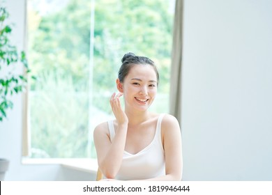 Beauty image, Asian woman smiling  at home