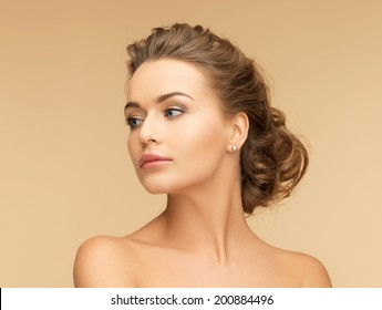 beauty and jewelery concept - beautiful woman with pearl earrings