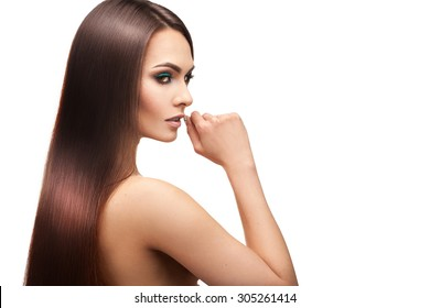 Beauty lady with makeup and perfect straight hair on white background in studio
