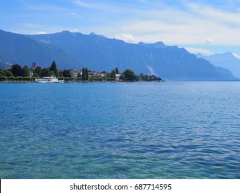 Beauty Lake Geneva landscape seen from promenade in VEVEY city in SWITZERLAND, panoramic view on swiss alpine mountains range with clear blue sky, 2017 warm sunny summer day Europe on July