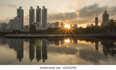 Beauty landscape, sunrise over modern building in the park at Bangkok, Thailand (Benchakitti Park)