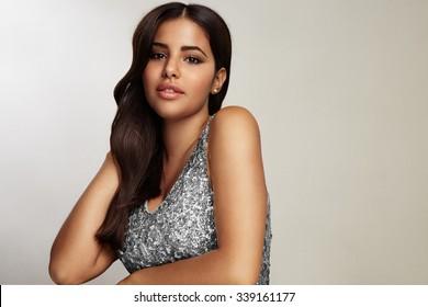 beauty latin woman wearing evening dress