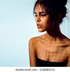 beauty latin young woman in depression, hopelessness look, fashi