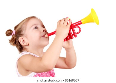 beauty little girl play trumpet