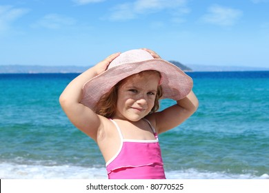 beauty little girl with straw hat on beach