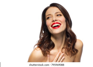 beauty, make up and people concept - happy laughing young woman with red lipstick over white background
