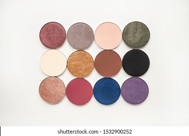beauty and makeup concept. twelve different shades of shadow in round shapes on a white background