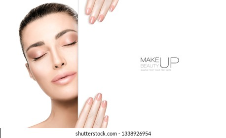Beauty Makeup and Nail Art Concept. Beautiful fashion model woman with nude makeup, perfect skin and trendy nude nails, closeup face with a white card template. High fashion portrait isolated on white