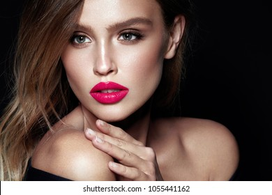 Beauty Makeup. Woman With Beautiful Face And Pink Lips. Close Up Of Beautiful Young Elegant Female Model With Glamorous Sexy Makeup, Soft Smooth Skin And Plump Full Pink Lips. High Quality Image.