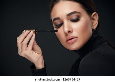 Beauty Makeup. Woman With Long Black Eyelashes And Mascara Brush