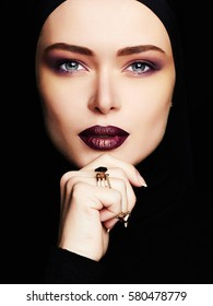 beauty make-up.beautiful woman in trendy fashion jewelry ring.pretty young muslim woman face.cosmetics concept