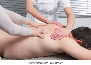 Beauty massage in the spa salon make four hands