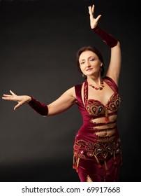 Beauty mature woman dance in arabic costume
