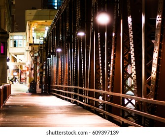 Beauty of the metal bridge at night in Chicago.