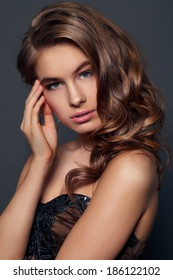 Beauty Model Girl with Long Healthy Wavy Hair and Perfect Makeup.