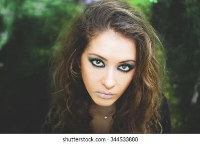 Beauty model girl with makeup smoky eyes