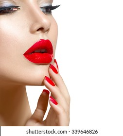 Beauty model Girl with Red Sexy Lips and Nails closeup. Manicure and Makeup. Make up concept. Beautiful woman face closeup over white. Filler injections. Lip augmentation, Beautiful Perfect Lips.
