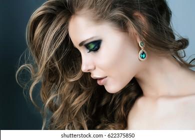 Beauty model green smoky eyes make up Face close up